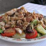 Warm chicken and bacon salad, comes with bread and butter aside.