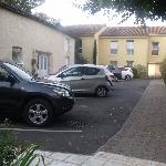 small hotel car park with annex in the background