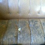 Couch in community room that children sit on - moldy