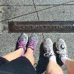 Feet at the former Berlin Wall