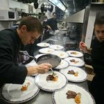 Cheff Carlos Alconchel finishing meat dishes