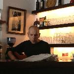 Bartender playing his guitar for us.