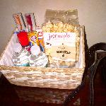 in-room welcome basket with snacks, necessities