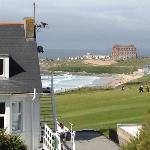 view of sea and golf