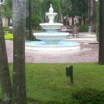 Fountian by pool on rainy day