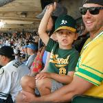 A dad & his boy rooting for the home team.