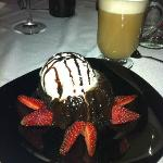 Chocolate cake with ice cream and a latte