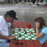 The husband and daugther playing checkers