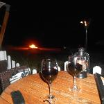 Romantic evening on the beach with Bon fire, wine, sand and candles