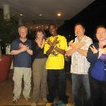 "Four of us doing the ""Octo"" sign after he dropped us back at our hotel in Nairobi."