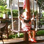 my grandson Alfie loving the swing seats at el nido
