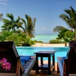 Relax by the pool and view the Indian Ocean