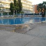 The pool in the evening with another hotel in the backgrounf
