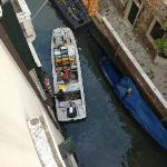 Morning view from our room of a boat bringing the fruit & veg to the hotel