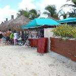 Cabanas and vendor on beach