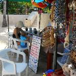 Vendor who sells local wares including jewelry, ceramics you can paint etc.