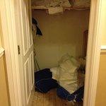 Open linen cupboard in corridor