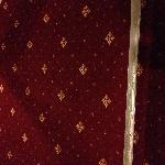 Duct tape on corridor carpet on step