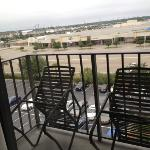 view of small balcony, facing parking lot
