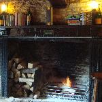 Lovely fireplace in restaurant area to the right as you walk in