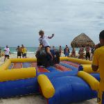 Mechanical bull riding on the beach