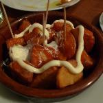 Papas bravas (fried potatoes with chili dressing & oil)
