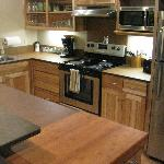Full kitchen in double queen suite