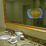 Integrated vanity mirror television in junior suite room
