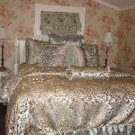 Plush bed of the Rose Room