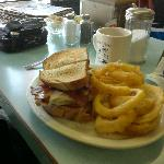 The turkey club, with onion rings.