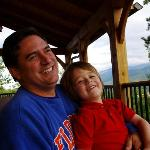 Husband and son, post-giggles on the deck with the Smoky Mountains as a backdrop