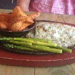 Mahi entree with grilled asparagus and seasoned potato wedges.
