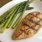 Grilled chicken breast and grilled asparagus, ordered a la carte.