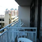 Balcony with next door room balcony on right. Parking garage also shown