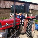 Kids playing on the tractor
