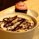 Our Cappuccino with chocolate or caramel topping.