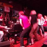 two of my friends and other patrons on stage.