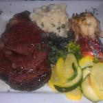 Prime rib, lobster, assorted vegetables, and mashed potatoes.
