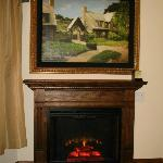 TV behind picture and fireplace