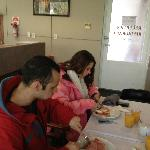 Enjoying and hearty breakfast before a day of skiing