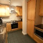 Kitchen in Superior Three Bedroom Apartment