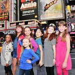 The orphans of ANNIE in front of the Palace Theatre marquee