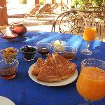 Breakfast starts off with traditional Moroccan bread, butter, jams, olive and fresh orange juice