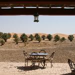 The dining terrace with sand dunes in the background.