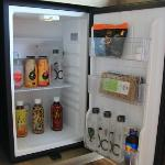 """mini fridge """" half torn opened tom yum cashew nuts"""" pack . all the items are on house compliment"""