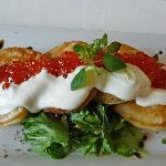 Blini with salmon roe and sour cream