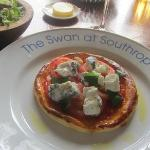 Tomato and goat cheese tart with salad