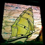 sunrise through stained glass in room #61