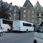 Buses parked in front of Stanley Thompson Wing E facing rooms