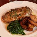 Pan-fried trout with wedge potatoes and spinach